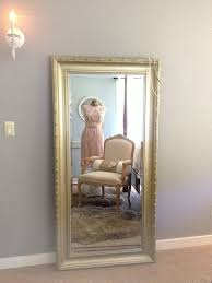 gold ornate wall mirror large leaning