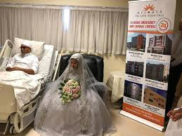 hospital bed after surviving robbery