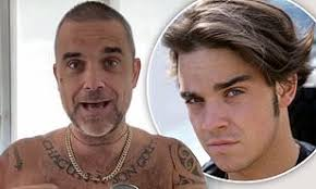 Robbie Williams has dyed his 'thinning' hair during lockdown ...