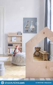Vertical View Of Stylish Kids Room With Pouf And Toys Real Photo Stock Image Image Of Natural Books 150757345