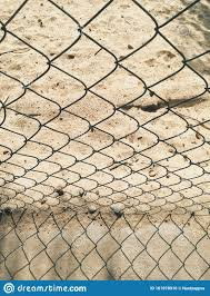 Sand Behind The Metal Fence At Sunrise Stock Photo Image Of Background Blurry 161078010