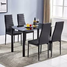 dining table set and 4 white chairs