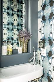 blue bathroom with eskayel wallpaper
