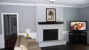 white brick fireplace with black mantle