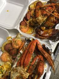 Garlic snow crabs and hot wings. With ...