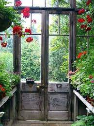 sweet garden shed with lots of windows