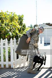 Military Woman Greeting Her Dog At Picket Fence High Res Stock Photo Getty Images