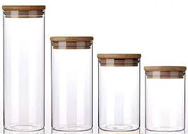 large glass storage jars with wood lid
