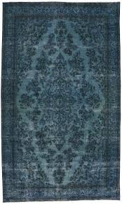 overdyed blue persian rug with modern