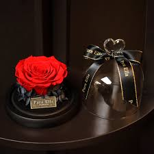 fresh preserved rose with glass bottle