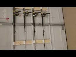 diy garage door fishing rod storage