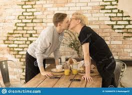 same couple kiss each other