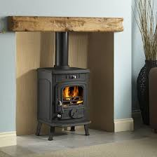 wooden mantel above a wood burning stove