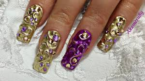 glamorous 3d golden purple swirl nails
