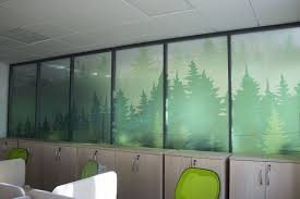 Green Trees Displayed On An Office Glass Wall With Clear Vinyl
