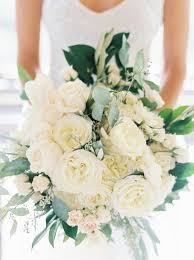 white bridal bouquets with greenery