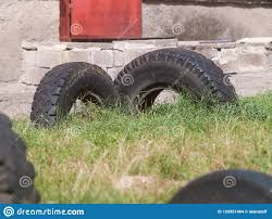 Old Car Tires Dug Into The Ground Stock Photo Image Of Rubber Recycle 125951464