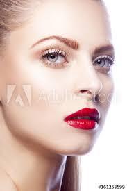 woman face red lip makeup blonde hair