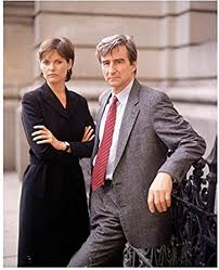 Law & Order A.D.A. Ross with A.D.A. McCoy leaning on fence 8 x 10 Inch  Photo at Amazon's Entertainment Collectibles Store