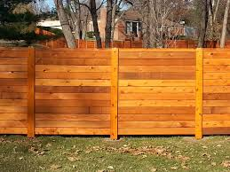 This Beautiful Horizontal Western Red Cedar Fence Was Created From Deck Boards It Creates A Powerful Presence In Y Fence Design Fence Styles Horizontal Fence