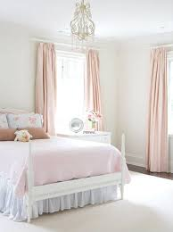 pretty pink curtains and bed from