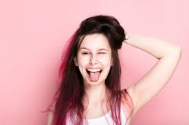pink tousled hair without makeup makes