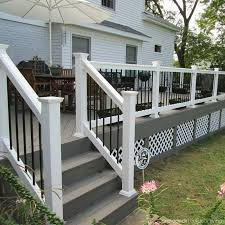 Slightly Raised Above Grade Level This Deck Design Includes Low Maintenance Timbertech Gray Decking White Rails With Blac Building A Deck Patio Deck Diy Deck