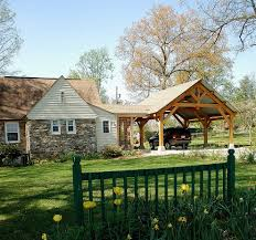 Attached Carport Plans Deck Farmhouse With Bronze Outdoor Wall Lights And Sconces