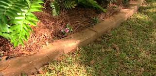 pour concrete curbing in your yard