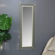 tall slim gold metal framed wall