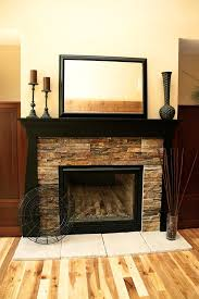 stacked stone fireplace with wood