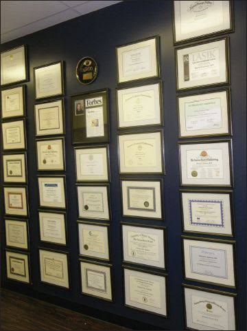 Image result for a wall full of framed degrees and diplomas., pics.""