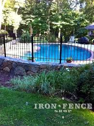 Wrought Iron Fence Installed On A Stone Wall Around A Pool And Curved With Angle Brackets 3ft Tall Classic In T Iron Fence Fence Landscaping Fence Around Pool