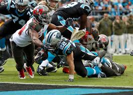 Carolina Panthers' Christian McCaffrey (22) runs for a touchdown as Tampa  Bay Buccaneers' Adarius Taylor (53) defends in the first half of an NFL  football game in Charlotte, N.C., Sunday, Nov. 4, …  