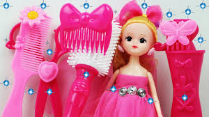 cute baby doll doing makeup with toy