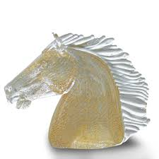 sculpture of horse head with gold leaf