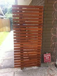 Simple Side Fence To Hide Garbage Cans And Meters Hide Trash Cans Trash Cans Outdoor Trash Cans