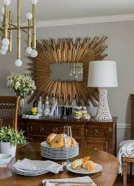 rectangular gold sunburst mirror over