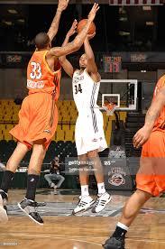 Ivan Harris of the Erie BayHawks shoots over Cory Underwood of the ...