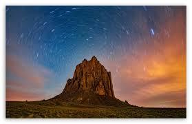 beautiful star trails over shiprock