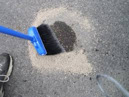 clean oil spills from your driveway or