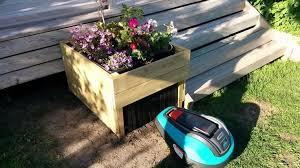 robot lawn mower garage planter
