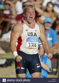 Adam Nelson of the USA reacts to a called foul on his final throw of the  competition forcing him to settle for ...
