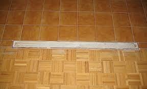 filling the gap on the tile floor where