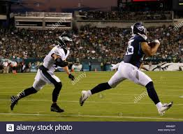 Philadelphia, USA. August 8, 2019: Tennessee Titans tight end MyCole Pruitt  (85) catches the touchdown pass with Philadelphia Eagles linebacker Nate  Gerry (47) defending during the NFL game between the Tennessee Titans
