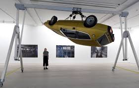 there s a car spinning on the ceiling