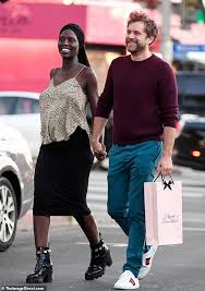 Jodie Turner-Smith hides her burgeoning baby bump during happy ...