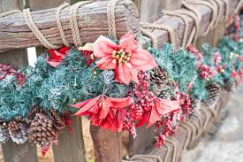 Wood Fence Decorated For Christmas With Red Flower Stock Photo Picture And Royalty Free Image Image 91368996