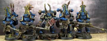 The Prodigal Sons wear Power Armour in the Legion colours of the Thousand  Sons, favoring royal blue with gold trim as w… | Thousand sons, Power  armour, Human puppet