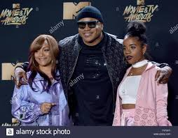L-R) Simone Smith, rapper LL Cool J, and Nina Simone Smith attend ...